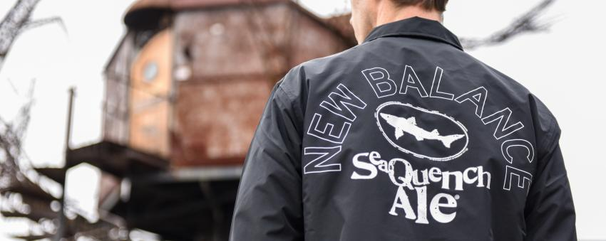 Back of SeaQuench Ale-themed New Balance jacket