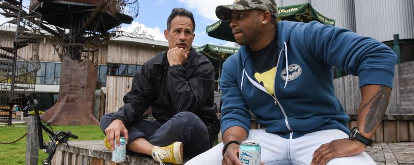 Sam Calagione & Jimmie Allen having a beer