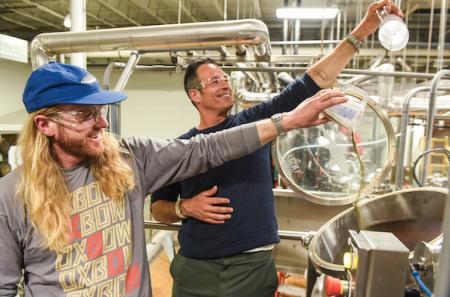Tim Adams & Sam Calagione brewing