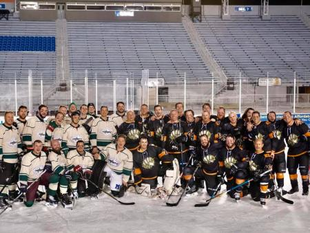 Dogfish Head hockey team standing on the ice.